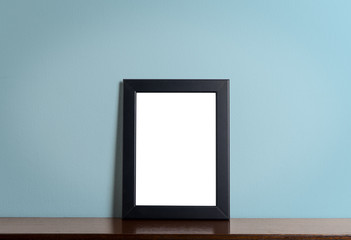 Black modern picture frame on Blue background. Black photo frame made of paper on a Blue cement background.
