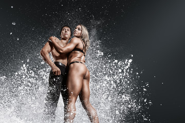 Bodybuilders muscular man and woman