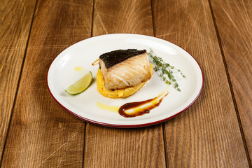 A beautiful seafood dish on a wooden background