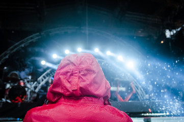 A man in a red hood