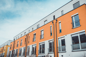 Row of modern apartments in yellow and orange