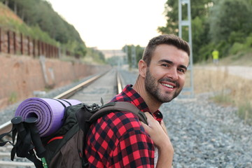 Hiker portrait. Male hiking man happy and smiling during hike trek. Beautiful young sporty model joyful.
