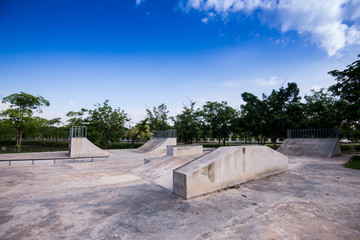 Empty skate park in the morning grind rails. Concrete cement.
