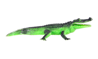 Plastic crocodile toy crawling isolated on white background.Plas
