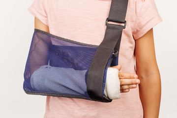 """Girl""""s broken arm in a cast. Concept of this photo is medicine"""
