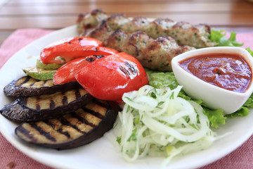 White plate with kebab