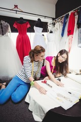 Two female fashion designers working together