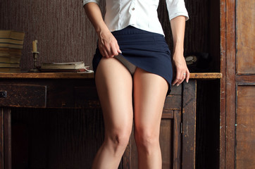 in an office style girl lifted her skirt and showing white panti Wall mural