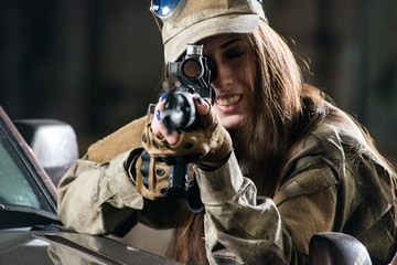 Girl in uniform with weapons in their hands