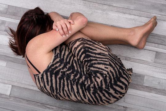 Depressed woman on the floor