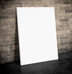 Blank white paper poster on the grunge brick wall and black ceme