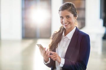 Portrait of happy woman using digital tablet