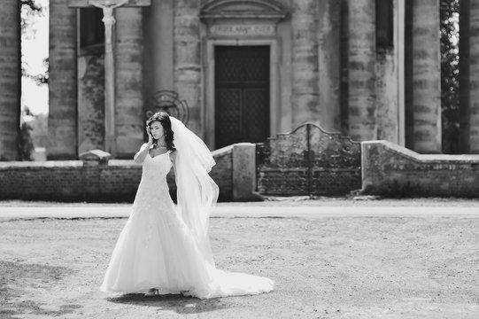 Bride walking next to old church