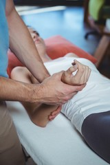 Physiotherapist massaging hand of a female patient