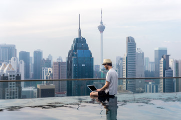 Businessman in an infinity pool