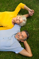 Senior couple lying on grass