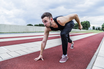 Athlete preparing for training or competitions on running track