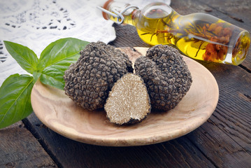 fresh  black  mushroom truffle on a wooden plate