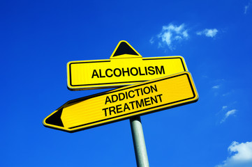 Alcoholism vs Addiction treatment - Traffic sign with two options - appeal to overcome addictive alcohol abuse and dependence through detoxifiction, treatment, rehabilitation and abstinence