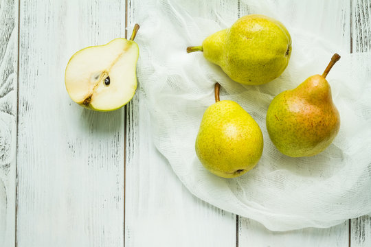 Fresh ripe pears on a table with napkin