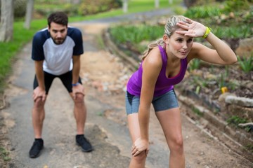 Couple feeling exhausted after jogging