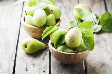 Sweet green pears on the wooden table