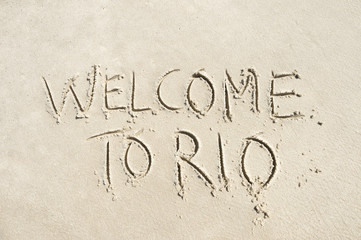 Welcome to Rio (as in, de Janeiro, Brazil) message handwritten in smooth sand on the beach in Ipanema