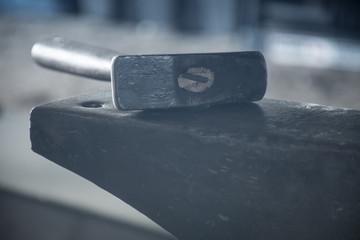 Blacksmith's hammer on anvil
