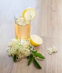 Fresh spring elderflower juice decorated with slice of lemon