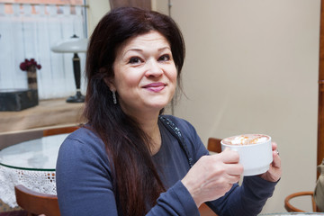 portrait of mature woman in cafe