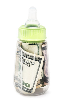 Baby bottle filled with cash.