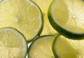 Background image of sliced green limes. Back lit.