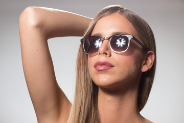 Young woman beauty sunglasses head arm up raised