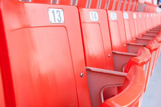 Grandstand seats in stadium, Empty seats in a day without sports,Empty bright red stadium seats