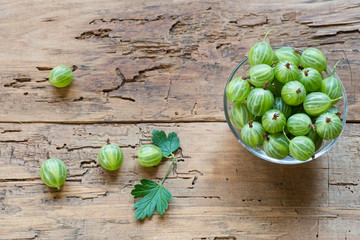 Fresh gooseberries in bowl on table close-up