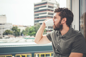 Young man drinking morning coffee