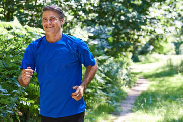 Mature Man Running Outdoors In Countryside