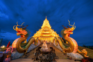 Golden Pagoda nine tier with dragon texture at Chinese temple -