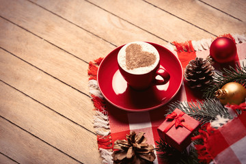 cup of coffee and christmas decorations