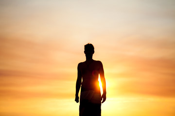 Silhouette man in summer sunset
