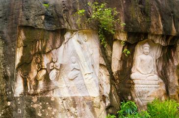 Sculptures of Buddha on sandstone,THAILAND