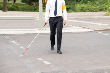 Blind Person Walking On Street