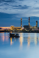 Oil refinery Riverside and Water reflection