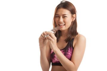 Beautiful healthy Asian girl love chocolate.