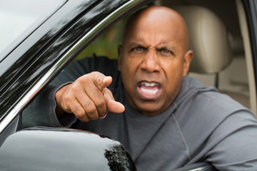 Angry man upset with drivers and gesturing with his hands.