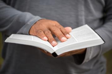 Man reading a Bible.
