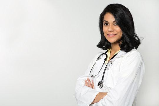 Hispanic doctor in an exam room.