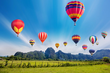 Colourful hot-air balloons flying over the mountain.
