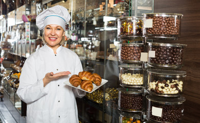 saleswoman posing with ganaches