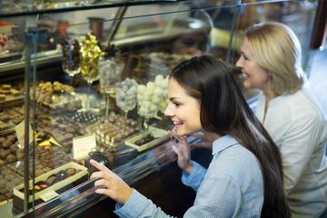 women buying dark and white chocolate filled candies